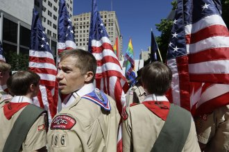 Boy Scouts from the Chief Seattle Council carry U.S. flags as they prepare to march in the Gay Pride Parade in downtown Seattle in June 2013.