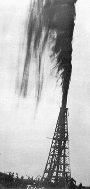 Spindletop blows in.